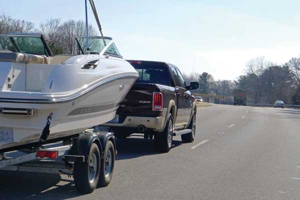 Photo of a truck towing a boat