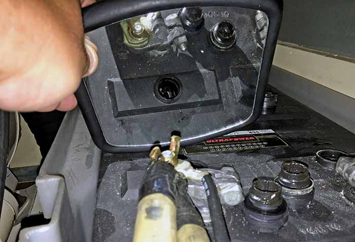 Checking battery with hand-held mirror