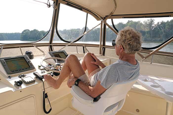 Tom Neale at the helm of his new boat