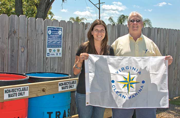 Holding a Virginia Clean Marina flag