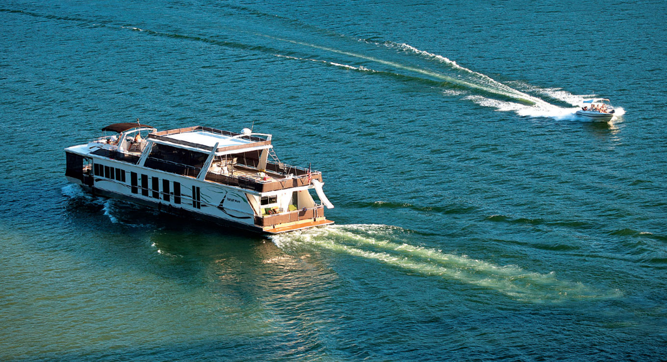 Houseboat cruising through open water