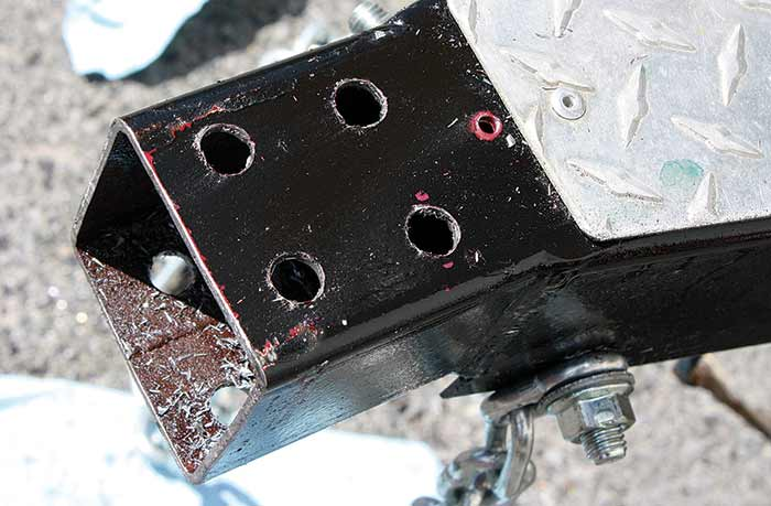Drill holes for hinge bolts