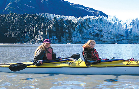 Yarrow and her mom kayaking by Margerie Glacier