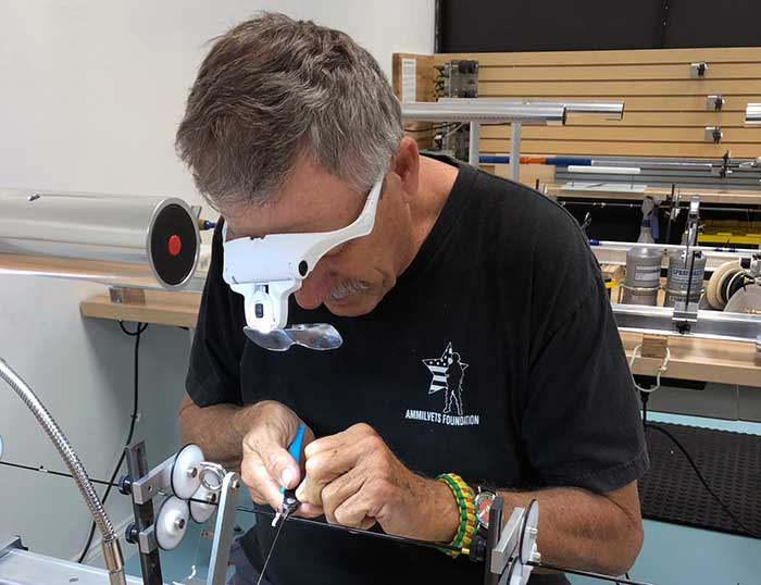 Dave Tucker working on rod