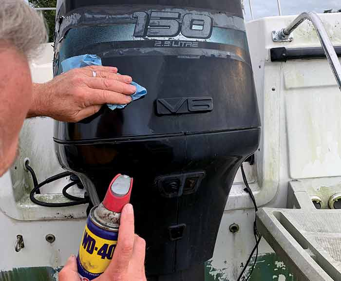 WD40 and old Mercury outboard hood