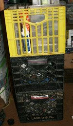 Fishing tackle stored in stackable milk crates