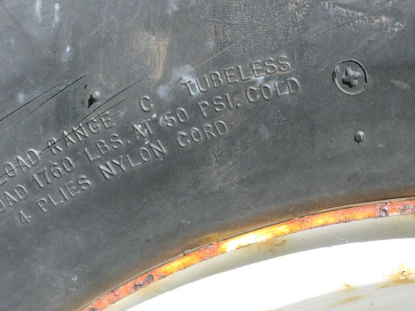Photo of load range printed on a trailer tire
