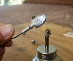 Heating the lead part of a fishing lure before painting