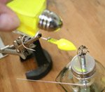 Sprinkling powder paint on heated lure