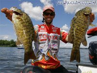 Bassmaster Pro Mike Iaconelli holding two bass