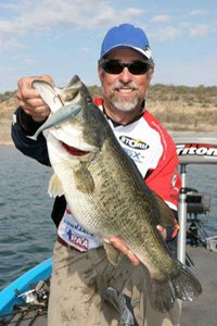 Pro Angler Ken Cook holding up a largemouth bass