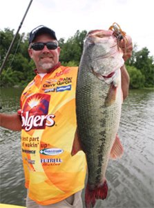 Pro angler Scott Suggs holding up a nice bass