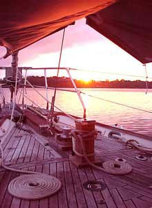Photo of Ithaka, under her forward awning, at dawn