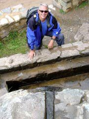 Photo of Douglas at an Inca ceremonial fountain in Peru