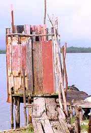 Photo of an outhouse on the water