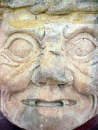Photo of a carved head at Copan Ruinas