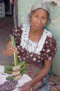 Photo of woman selling crabs woven with palm leaves,