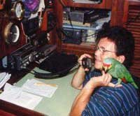 Photo of Donna at Victoria's nav station, with their parrot