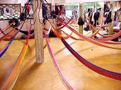 Photo of children's dorm of hammocks at Ak'Tenamit