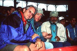 Photo of Douglas, Harold and Jose at a baseball game.
