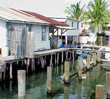Photo of houses on the Cay are built up over the water on stilts