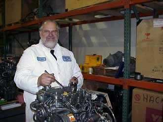Photo of Larry Berlin teaching boat engines maintenance