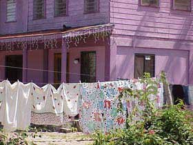 Photo of Laundry hanging outside colorfully painted homes