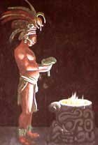 Photo of Mayan holding a human heart over the fire in sacrifice