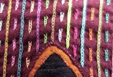 Photo of close-up of mola-stitches