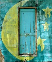 Photo of moon painted on door