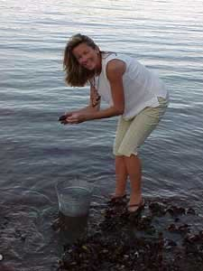 Photo of Bernadette picking mussels