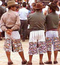 Photo of Santiago men wearing embroidered pants