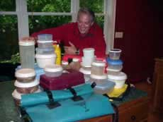 Photo of Douglas with a multitude of tupperware containers