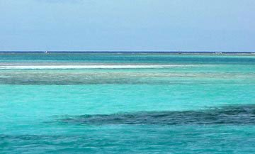 Photo of turquoise waters and craggy reefs