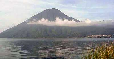 Photo of volcanoes of Lake Atitlan, shrouded in morning mist