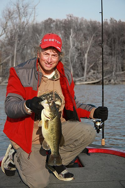 Photo of Capt Steve Chaconas holding a largemouth bass