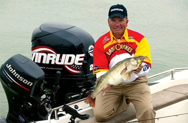 Photo of Pro Walleye Tour angler Eric Olsen holding a nice catch