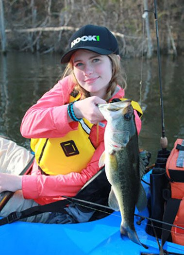 Photo of young angler Callie Shumway holding up her largemouth bass catch