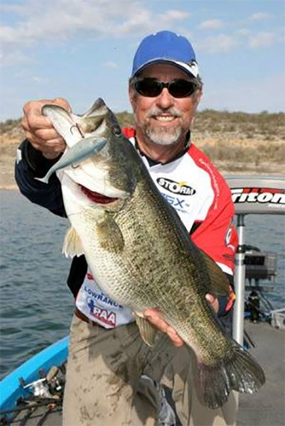 Photo of Pro Angler Ken Cook holding up a largemouth bass