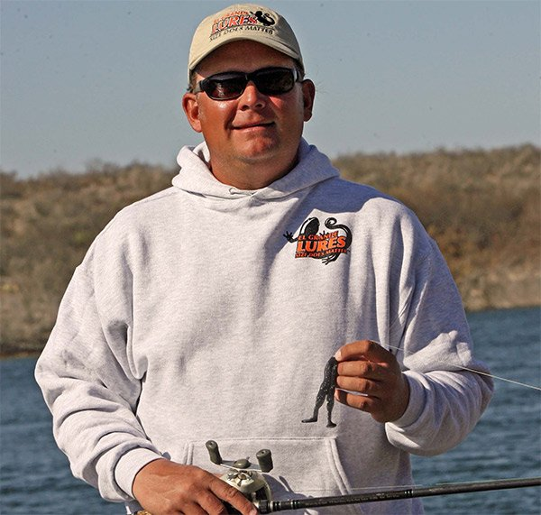 Photo of Bass Elite Pro Kurt Dove holding a fishing bait