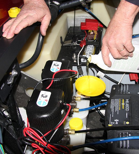 install your own power poles fishing boatus photo of pouring the marine biodegradable hydraulic fluid into the tanks