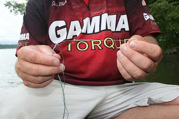 Photo of pulling needle through braided fishing line
