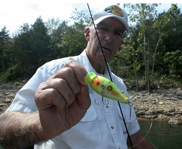 Photo of Charlie Campbell holding his Classic Waker lure