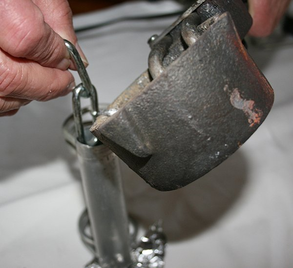 Photo of pouring lead in the plug knocker tube