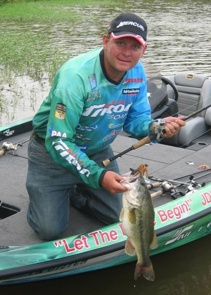 Bassmaster Elite Pro Kurt Dove in his boat with a nice catch