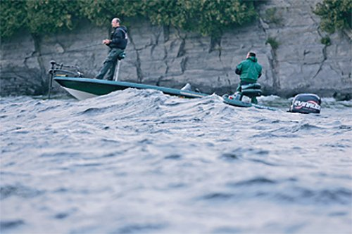 Photo of bass fishermen boating in rough water