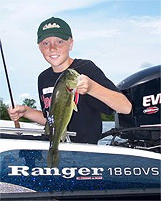 Photo of a young angler holding a bass