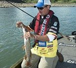 Photo of pro angler Jeff Kriet with a northern Pike