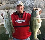 Photo of pro angler Kurt Dove with two bass