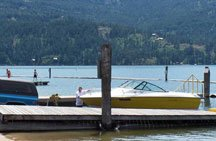 A yellow ski boat sits at the dock